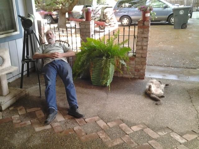 My dad and the cat fell asleep together.